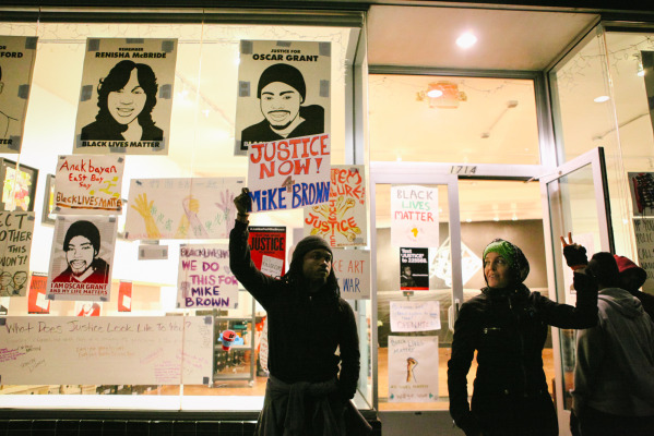 SoleSpace in Uptown Oakland dedicated its storefront to posters of solidarity with protesters following the release of the Ferguson grand jury verdict. November 24, 2014. (Photo by Bonnie Chan)